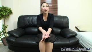 Horny milf sits on the couch and is talked into some sexy play