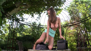 Skinny brunette rides her favorite sybian sex machine outdoors