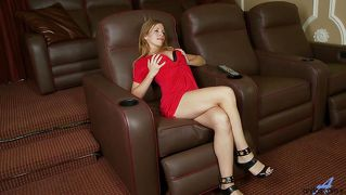 Blonde slut masturbates on an armchair