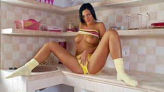 Tall leggy brunette adria in yellow shorts shows off her massive natural boobs and flashes her shaved pussy. then alluring girl with sweet big tits bares her hot ass. watch her strip in the kitchen.