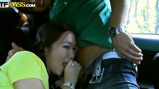 Asian college chick heidi wants starts sucking in the car before the hot party