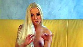 Long haired blonde jade with big fake tits spreads her sexy long legs on the couch and inserts white dildo in her fuck hole. watch fascinating big boobed doll toy fuck her wet snatch.