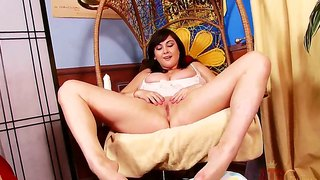 Giant boobed brunette beverly paige naughtily playing her boobs and dildoing her cunt at home!