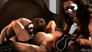 Masked lesbian mistresses put it to their slave and eat some pussy