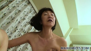 With her slim legs wide open, the milf has him drilling her hairy twat nice and deep