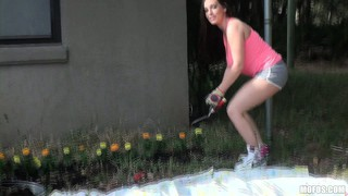 Busty brunette cutie got her gardening interrupted for a titty show