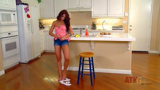 Red-haired sweet girl adriana chechik strips down to her tiny panties in the kitchen with banana in hands. she spreads her pussy lips and gives a close-up view of her pink snatch.