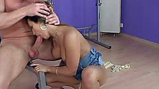 Slim brunette babe with firm ass and juicy hooters in stripper shoes and short skirt gets her shaved twat pounded in doggy style position by tattooed dude in the gym