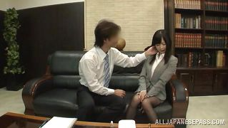 Japanese hottie sucking a cock in the office