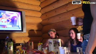 Naughty college coeds party hard at the country log cabin and get naked