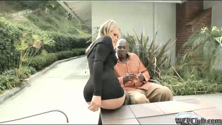 Dazzling blonde in a sexy black dress steps outside and fucks a big black cock