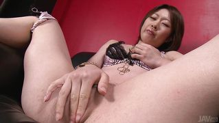 Japanese girl uses dildo on her pussy
