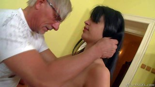 Naomi s is s pretty brunette with massive natural tits. topless brunette in white fishnet stockings gives breast job to older man before stroking his dick with her sexy hot feet.