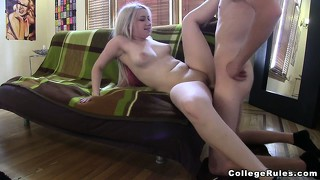 Blonde college girl rammed by a student doggy style on the sofa