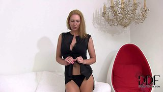 Naughty amateur blonde milf with stunning blue eyes and firm ass in sexy black dress and undies reveals her unreal round firm hooters at the interview filmed in close up