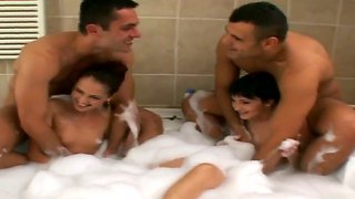 Sandra and suzie horny group sex in the foamed bath