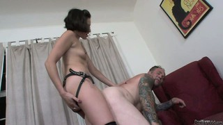 Abundantly inked stud pulling the pud while getting ass-fucked by a babe with strap-on