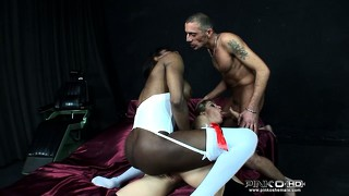 She sucks her man's cock while being fucked by a chick with a dick