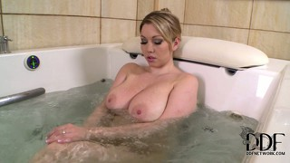 The stacked blonde finds comfort and pleasure in that relaxing and soothing bath