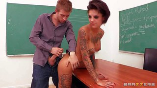 Tattooed and sexy brunette teacher bonnie rotten gets totally stripped and reveals her nice body and all the tattoos while getting nailed by horny dude danny d from behind in classroom
