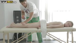 Blonde with white skin receives an oiled massage