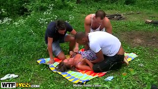 Cute girl july gets banged by three guys in nature