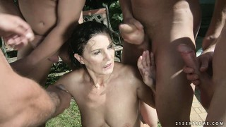 Crusty old brunette margo is in an outside gangbang getting pissed on