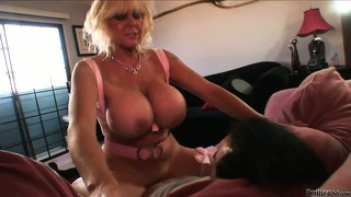 Horny granny with big tits takes on the couch like a horny bitch
