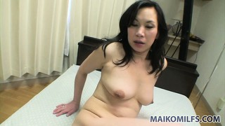 The asian babe enjoys the hardcore adventure on the bed and her cunt gets creampied