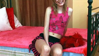 Pale skinned teen girl izabella in short skirt flashes her hairy pussy on the edge of the bed before she plays with pink dildo for you to watch. this cutie loves doing it on camera.