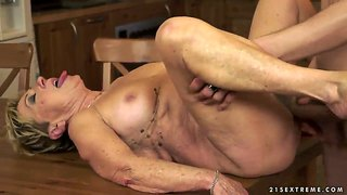 Horny granny gets a servicing on kitchen table
