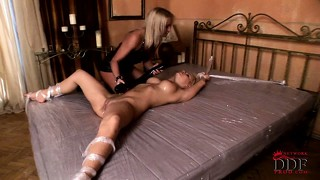 Lusty lesbians play bdsm and use a big dildo and licks her cunt