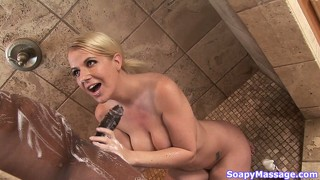 Busty blonde loves black meat and suds him up in shower and tub
