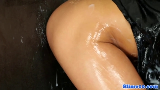 Euro brunette beauty sucks gloryhole and gets sperm showered