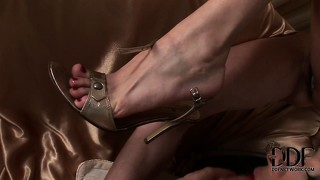 Two lesbian babes are thrilled with feet in a hot foot fetish video