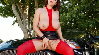 Busty brunette eva notty spreads her curvy body across the car, playing with her twat