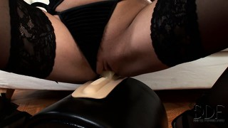 She rides the sybian like a champ, she cums all over her fuck machine