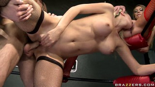 Wrestling babe made to go down on her kitty friend while taking cock from behind