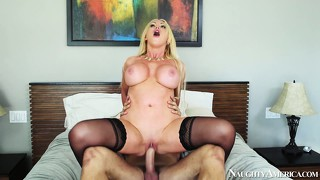 Slutty blonde milf nikki benz is looking sexy with her thigh high stockings