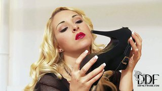 Glamorously beautiful blonde victoria summers takes off her black shoes before she plays with her bare feet. doll in see-through black dress rubs her neat feet gently in the bedroom.