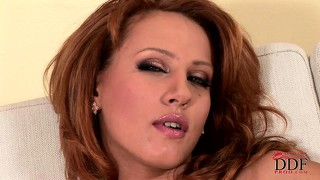 Redhead nataly has a hot ass and poses before sticking a plug in it