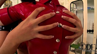 Latex lesbians do some fingering and ass licking in some bdsm