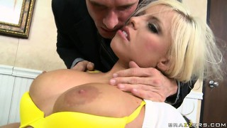 Bald man in black suit puts his face right between this girl's big titties