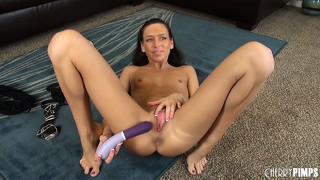 She toys her twat and then takes it out to taste her pussy juices