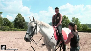 Gorgeous brunette with perfect tits enjoys some riding lessons in the outdoors