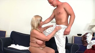 Erotic granny lily gives hunk stud a blow job as she rubs her pussy