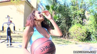 Hot ebony babe with big tits teasing a basketball player on the street