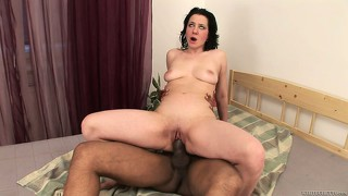 Horny brunette milf with cute tits gives the black cock experience a try