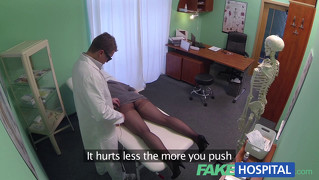 Female patient using massage tool for an orgasm