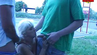 Mature whore sucking cock near a highway